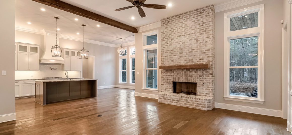 living with brick fireplace wood beam mantle